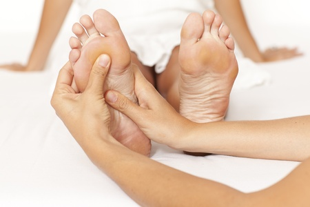 Human hands massaging a woman�s foot