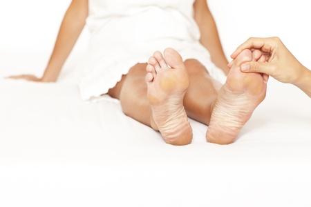 Human hands massaging a woman's toe Stock Photo - 11591956