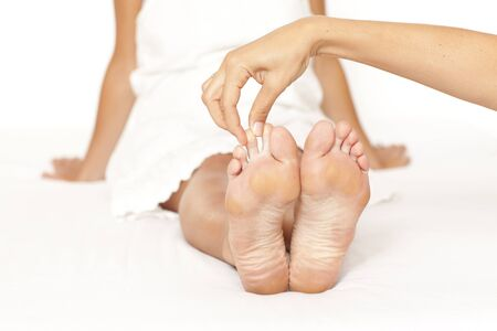 Human hands massaging a woman�s toe Stock Photo - 11591961