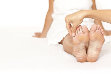 Human hands massaging a woman�s toe Stock Photo - 11591958