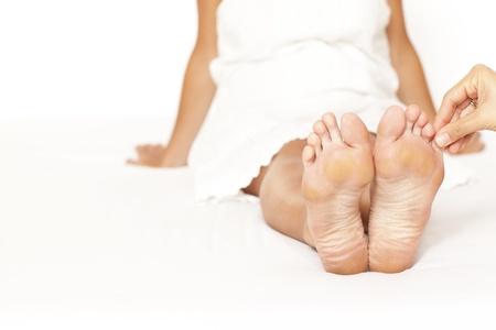 Human hands massaging a woman�s toe photo