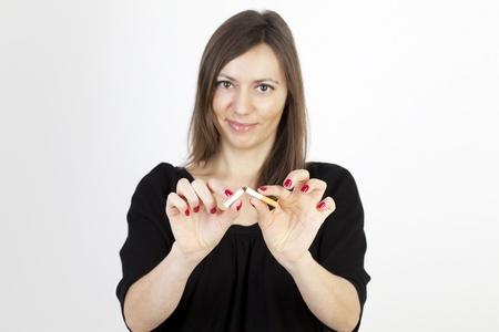 Woman breaking a cigarette photo