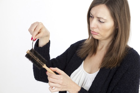 completely: Woman loosing hair Stock Photo