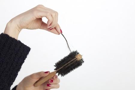 hair problem: Woman loosing hair Stock Photo