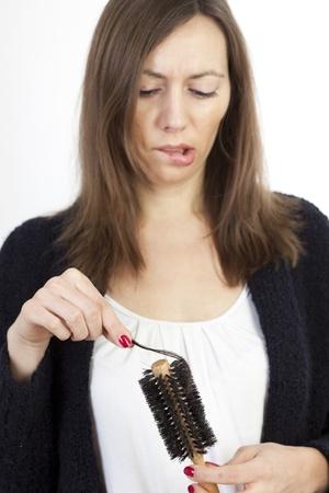 pressure loss: Woman loosing hair Stock Photo