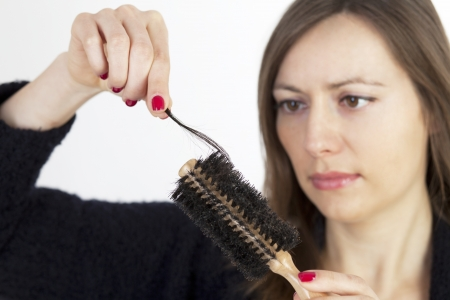 comb hair: Woman loosing hair Stock Photo