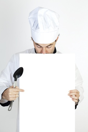Chef showing on a white paper photo