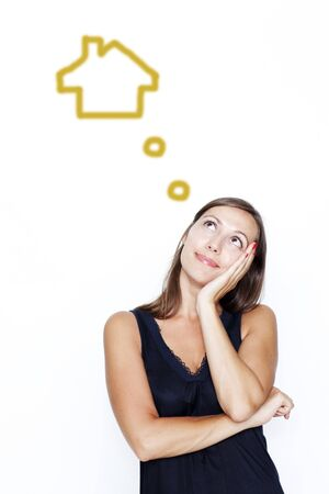 smart investing: woman dreaming about real estate Stock Photo