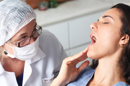Woman with toothache at the dentist photo