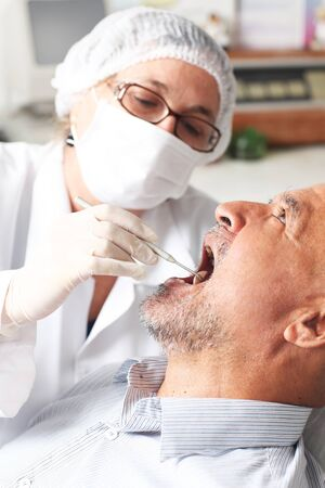 Hispanic man at the dentist photo