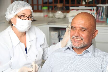 Middle aged man happy at the dentist Stock Photo - 12047643