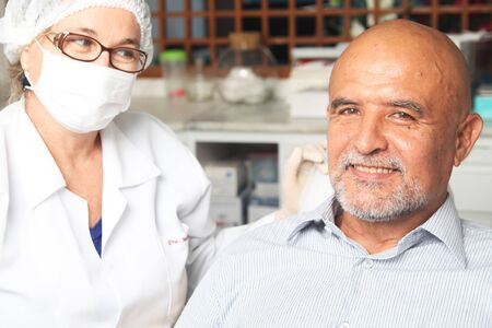 american content: Middle aged man happy at the dentist