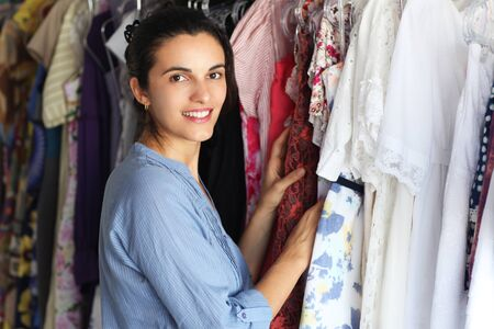 Beautiful woman in a store looking for clothes photo