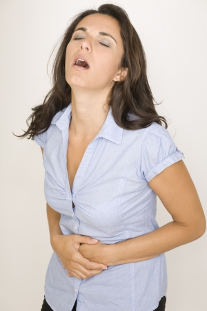 Beautiful woman suffering from stomachache photo