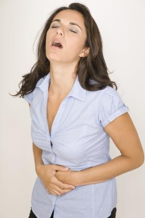 cramp: Beautiful woman suffering from stomachache