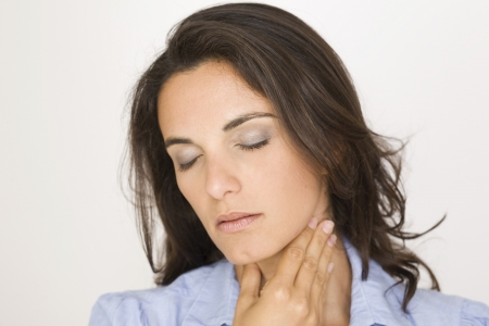 Beautiful woman suffering from sore throat Stock Photo