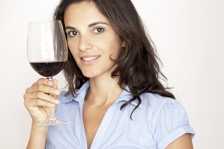 woman with a glass of red wine Stock Photo - 12308321