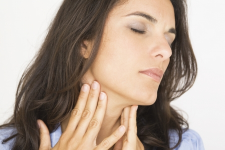 painful: Beautiful woman suffering from sore throat Stock Photo