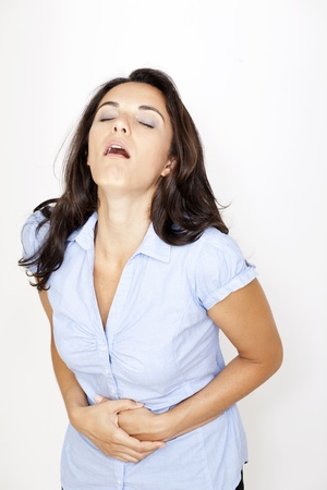 Beautiful woman suffering from stomachache Stock Photo - 12308358