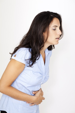 Latin woman suffering from stomachache photo