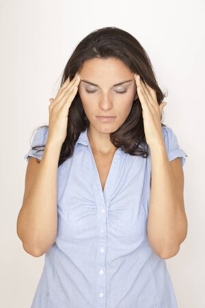 Beautiful woman suffering from headache Stock Photo - 12308367
