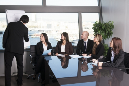 training group: Group of office workers in a boardroom presentation Stock Photo