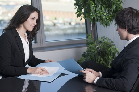 businessman and businesswoman negotiating photo