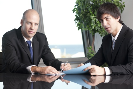 bald men: Successful business men at the office table