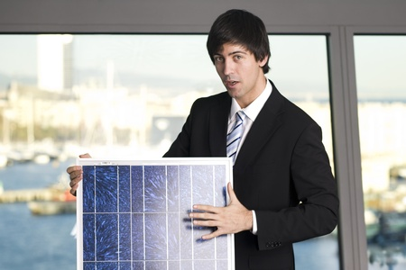Businessman explaining solar panel photo