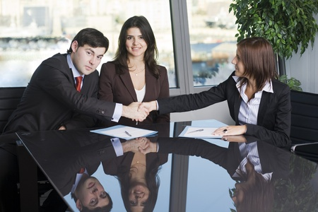 Businesswoman mediating and making business conciliation possible Stock Photo - 12308359