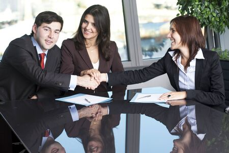 rapprochement: Businesswoman mediating and making business conciliation possible Stock Photo