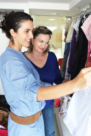 woman with an older woman buying clothes photo