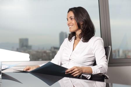 Self-confident latin businesswoman in office photo