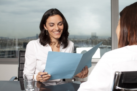 Insurance agent with client in a nice office photo