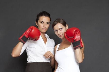 businesswomen hits with red boxing glove photo