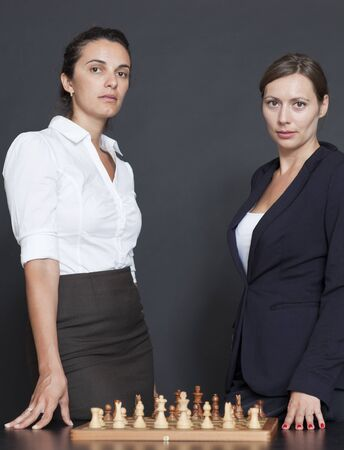 Two business women think about strategy photo