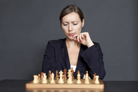 Business woman over a chess game photo