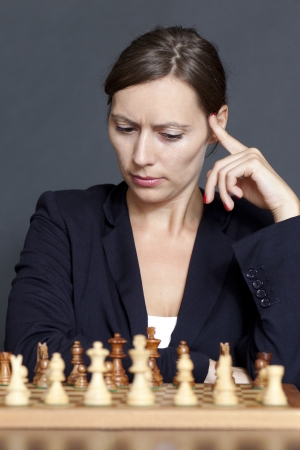 business game: Business woman over a chess game