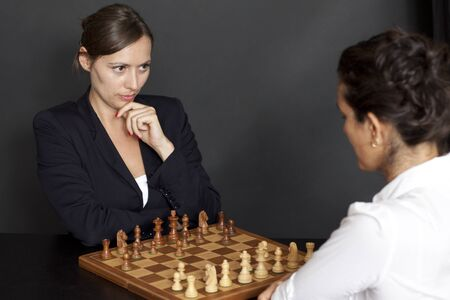 businesswomen play chess and think about strategy photo