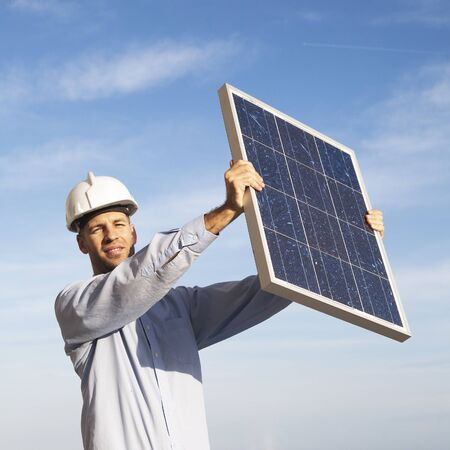 Businessman with solar panel photo