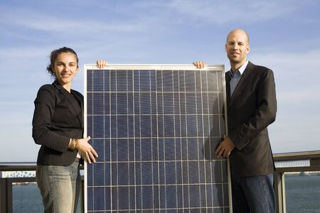 Businessmen carry a solar panel photo