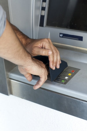 financier: Man enters the PIN number at the ATM Stock Photo