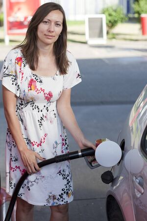 refuel: Woman fill up car Stock Photo