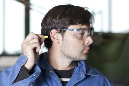 Blue collar worker at noisy workplace Stock Photo - 15277251