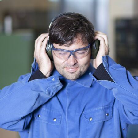 Blue collar worker at noisy workplace Stock Photo - 15277250