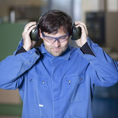 Blue collar worker at noisy workplace Stock Photo - 15277358