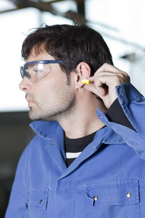 Blue collar worker at noisy workplace Stock Photo - 15277277