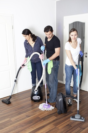 Three persons cleaning a house  photo