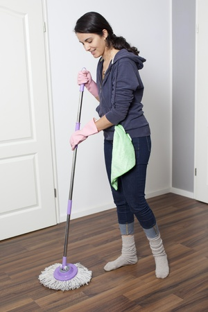 cleaning tools: Woman cleaning the flat Stock Photo