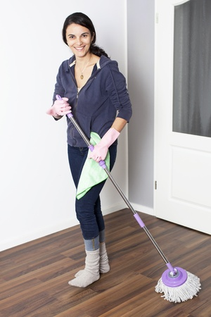 Woman cleaning the flat photo
